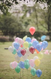 Balloons rising from the ground